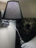Bedroom lamp. A bedroom lamp standing at a wall Royalty Free Stock Images