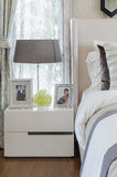 Bedroom with lamp on white table Royalty Free Stock Photos