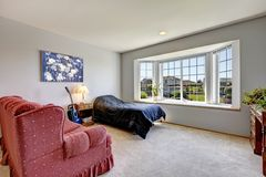 Bedroom with large window Stock Images