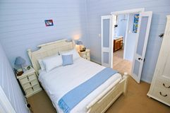 Bedroom with light blue walls Stock Image