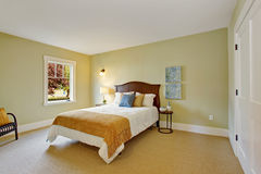 Bedroom in light mint color with white bed Royalty Free Stock Images