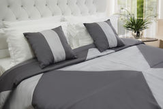 Bedroom linen. Elegant gray bedroom linen on king size bed Stock Images
