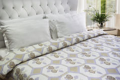 Bedroom linen. Floral bedroom linen on king size bed Stock Images