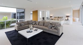 Bedroom and living room. Luxurious bedroom with living area in Australian mansion Royalty Free Stock Photography