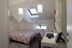 Bedroom in loft apartment stock photos