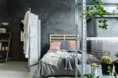 Bedroom in loft. Cozy contemporary bedroom in fancy industrial loft royalty free stock photos