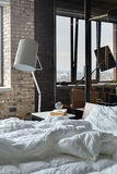 Bedroom in loft style Stock Images