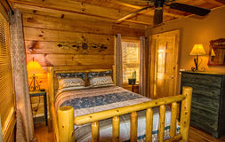 Bedroom in Log Cabin Stock Images