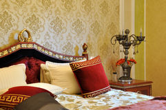 Bedroom in luxuriant and exquisite style. Luxury and noble style bedroom internal, with exquisite wall paper and decoration, shown as luxury, classical, and Stock Photos