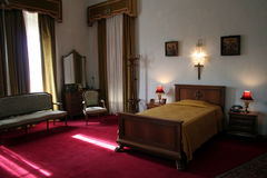 Bedroom in a luxury building. An Interior view of Bedroom in a luxury building Stock Image