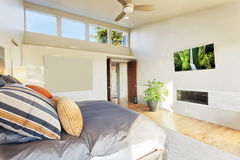 Luxurious Bedroom. Bedroom in luxury home with view of trees royalty free stock images