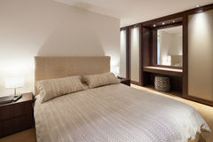 Bedroom of luxury house Stock Images