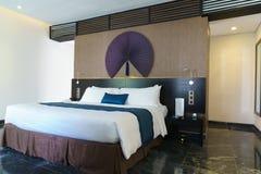 Bedroom of luxury suite in hotel in Vietnam. Stock Photo