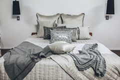 Bedroom in modern home with cushions Royalty Free Stock Photos