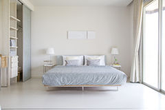 Bedroom in modern style stock photos