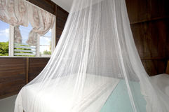 Bedroom mosquito net  guest house bequia. Bedroom with mosquito net in Caribbean island budget guest house bequia st. vincent and the grenadines Royalty Free Stock Images
