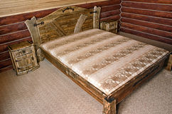 Bedroom with old-style wooden bed Royalty Free Stock Photography