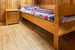 Bedroom in a Wooden Chalet. Bedroom with one bed in a wooden chalet Royalty Free Stock Photos