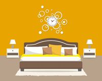 Bedroom in an orange color. There is a bed with pillows, bedside tables, a big round clock on the wall, lamps and other objects in the picture. Vector flat stock illustration