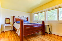 Bedroom with ots of windows and wood floor. Stock Photo