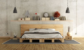 Bedroom with pallet double bed Royalty Free Stock Photo