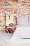 Bedroom with pallet night table. Bed and OSB wall decoration stock photography