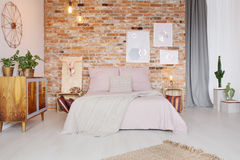 Bedroom with pallet side table Stock Image