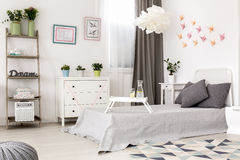Bedroom with paper decoration on the wall. stock photo