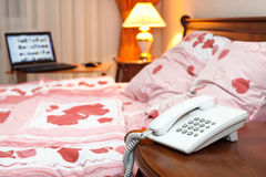 Bedroom phone and computer Royalty Free Stock Images