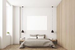 Bedroom with picture and wooden wall Stock Photos