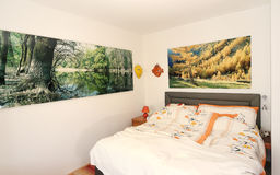 Bedroom with pictures and ceramics  Royalty Free Stock Photos