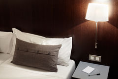 Bedroom, pillow and lamp at night Royalty Free Stock Photo