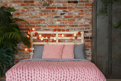Bedroom with pink bed Stock Images