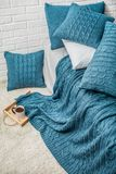 Bedroom plaid blanket pillow pattern decor interior. Interior bedroom decor plaid plaid turquoise with patterns pigtail texture and wall white brick Stock Photo