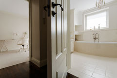 Bedroom with private bathroom. Horizontal view of bedroom with private bathroom Stock Images