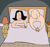 Bedroom problem. Couple in bedroom in bed looking despondent Royalty Free Stock Images