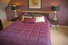 Bedroom in purple. Stock Image