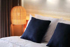 Bedroom with rattan lamp Stock Photos
