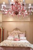 Bedroom with red chandelier Royalty Free Stock Photo