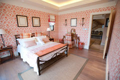 Bedroom with red flower wallpaper Stock Photo