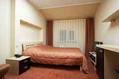Bedroom in red tones Stock Photos