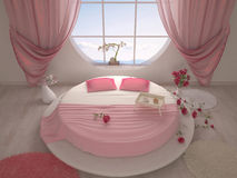 Bedroom with a round bed Stock Photo