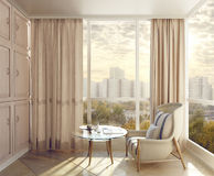 Bedroom seating area in sunlight with views of the city. Stock Photo