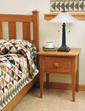 Bedroom with Shaker-style furniture. Bedroom with Shaker style bedroom furniture and handmade patchwork quilt Stock Photos