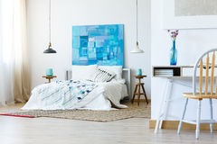 Bedroom in simple style. Bedroom in simple modern style with contemporary artworks royalty free stock images