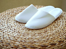 Bedroom Slipper on weave stool Royalty Free Stock Images