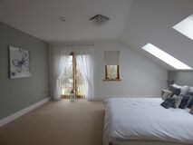 Bedroom with sloped ceiling Royalty Free Stock Image