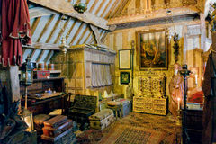 Bedroom in Snowshill Manor, Gloucestershire, England. Bedroom inside the Priest`s House at Snowshill Manor where Charles Wade slept Royalty Free Stock Photo