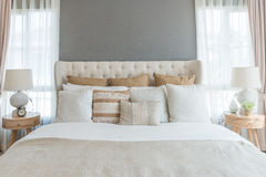 Bedroom in soft light colors. big comfortable double bed in eleg. Ant classic bedroom at home Stock Images