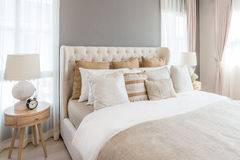 Bedroom in soft light colors. big comfortable double bed in eleg. Ant classic bedroom at home Royalty Free Stock Photography